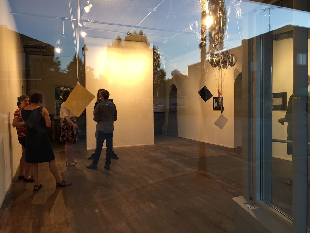 Visitors at Match Factory's grand opening and reception for Matthew Bakkom: Yesterday's Parties.